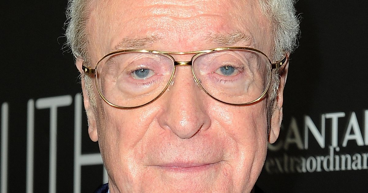 Michael Caine holds trusty walking stick as he recovers from ankle injury