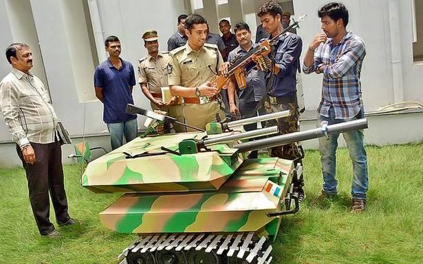 Earthmover operator makes models of battle tank, rifle