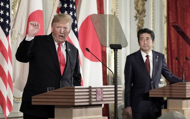 Trump breaks with Abe, says not bothered by North Korea missile tests
