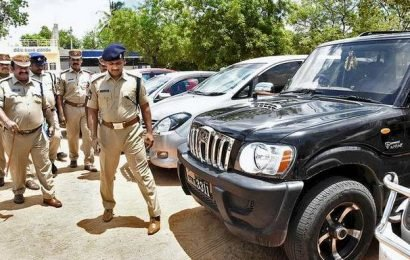 Two held on charge of duping car owners