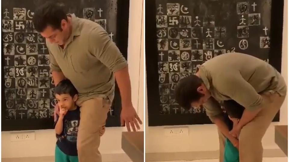 Salman Khan makes a mock attempt to free himself from nephew Ahil's clutches. Watch video