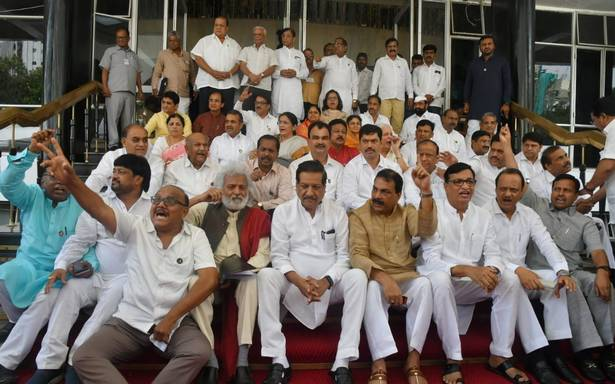 Protest in Maharashtra Assembly, rains in New Delhi, and other news in pictures