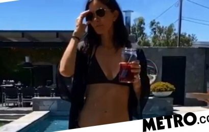Courteney Cox takes a dip in her pool with the help of Missy Elliott