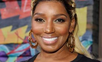 NeNe Leakes Shows Off Her Body in a Sexy Swimsuit Poolside