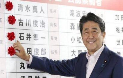 Japan's ruling coalition secures upper house majority
