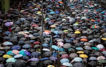 Hong Kong protesters throng streets under heavy rain