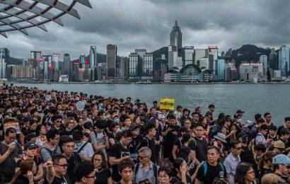 Civil servants join Hong Kong protests as Beijing accuses US