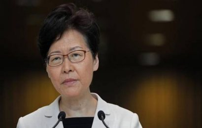 Hong Kong leader denies Beijing won't let her resign