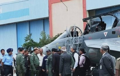 Top news photos: Rajnath Singh geared up to fly in LCA trainer, Rugby World Cup 2019, and more