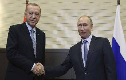 In Russia for talks, Erdogan threatens to restart offensive