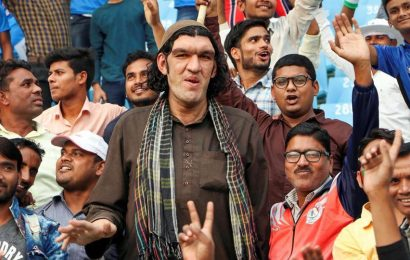 "At 8' 2"", Afghan cricket fan finds many admirers in City of Nawabs"