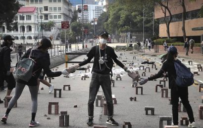 Hong Kong students arm themselves for showdown as police take breather