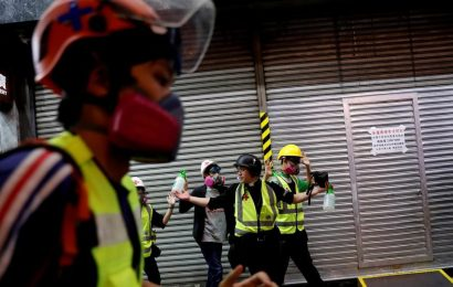 Asian shares waver, Hong Kong tensions spoil festive mood after upbeat US data