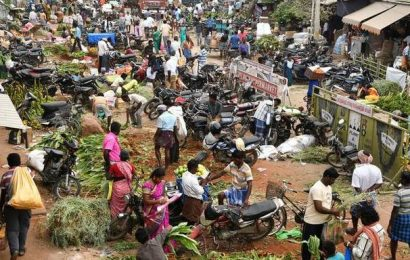 Top news photos: People throng markets ahead of Pongal, huge sinkhole swallows bus in China, and more