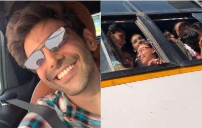 Kartik Aaryan shares video of kids in school bus singing Dheeme Dheeme next to his car. Watch