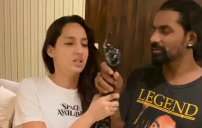 Remo D'Souza snatches award from Nora Fatehi in the middle of her acceptance speech. Watch hilarious video