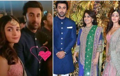 Alia Bhatt has a protective arm around Neetu Singh as they pose with Ranbir Kapoor at Armaan Jain's wedding reception. Watch