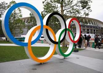 Tokyo drops kids from Olympics torch events as virus precaution
