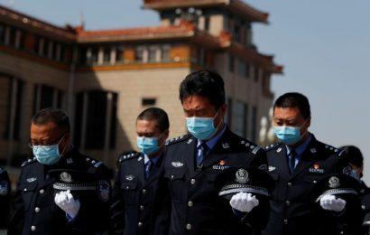China halts to honour coronavirus victims, 'martyrs'