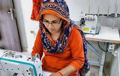 Woman entrepreneur stitches face masks for villagers