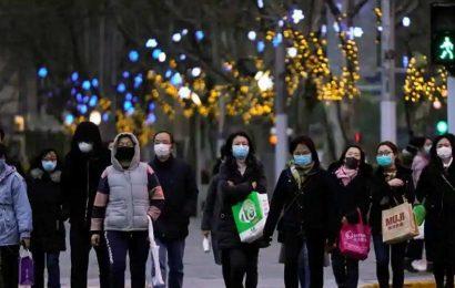 Beijing bans 'uncivilised' behaviour to improve public hygiene amid Covid-19 outbreak