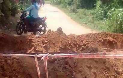 T.N. officials dig trench to prevent people from entering Chittoor district