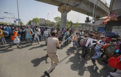Migrant workers, police clash in Ahmedabad