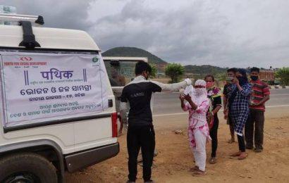 Women workers walking home receive sanitary napkins at Ganjam