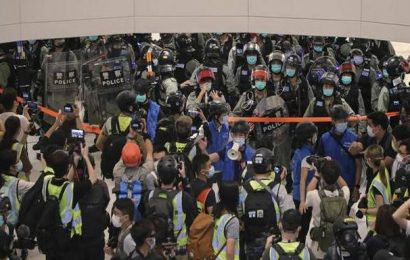 Hong Kong police use pepper spray to clear May Day protest