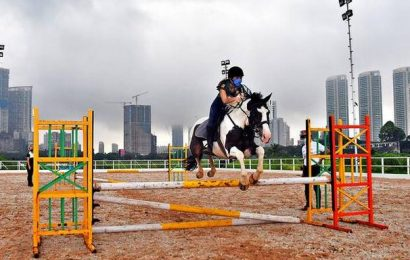 Amateur riders clear the first hurdle