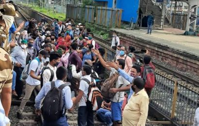 Not enough buses, non-essential workers block railway line at Mumbai station