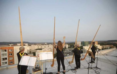 Musicians perform concert on rooftop amid pandemic in Germany