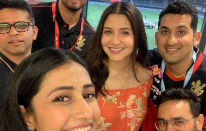 PIX: Anushka, Dhanashree cheer for RCB