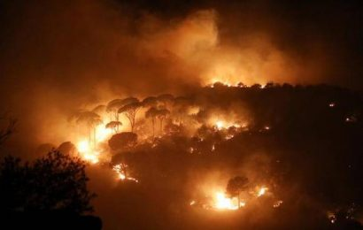 Mideast wildfires kill 2, force thousands to flee homes