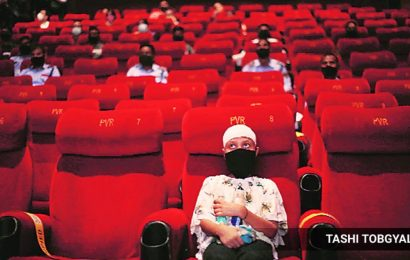 Delhi: Cinema halls reopen but patrons keep their distance from the box office