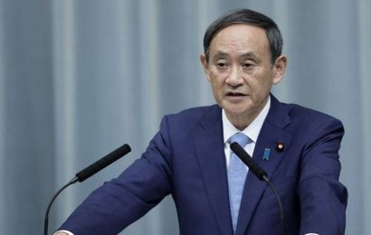Japan's Yoshihide Suga lands defense deal with Vietnam amid China tension
