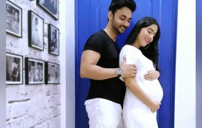 Amrita Rao shares photo of herself cradling baby bump as she enters ninth month of pregnancy: 'Too excited'