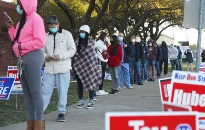 PHOTOS: Americans line-up at polling booths to elect 46th President