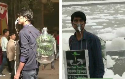Why this man is roaming around Delhi with a mask attached to a can filled with a plant
