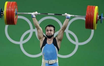 Olympic champion charged in weightlifting doping case