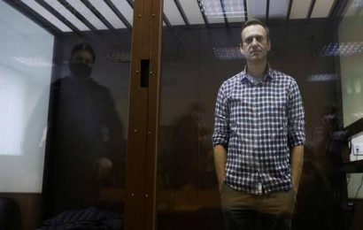 Jailed Kremlin critic Alexei Navalny says he risks solitary confinement over infractions