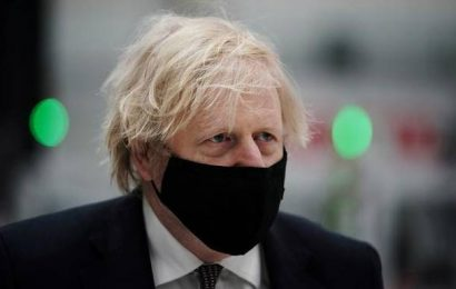 UK PM Boris Johnson marks lockdown anniversary with cautious message