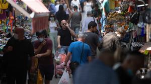 Israel lifts public mask mandate, opens schools