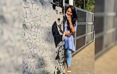 Anushka Shetty besides Charlie Chaplin