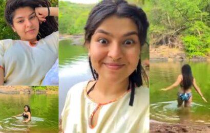 Bikini lady Nidhi in lake