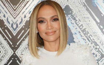 Jennifer Lopez Laid in the Ocean Wearing a Rhinestone Bra