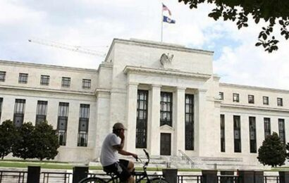 Shares slip, rupee falls as Fed signals earlier rate increases