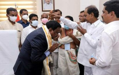 Siddipet Collector touches the feet of CM