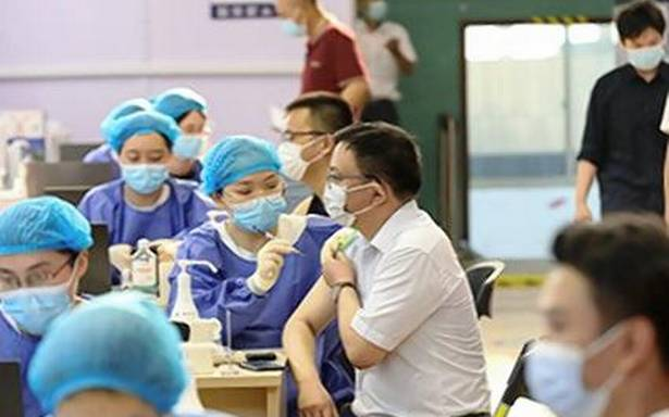China threatens to ban unvaccinated adults from schools, hospitals