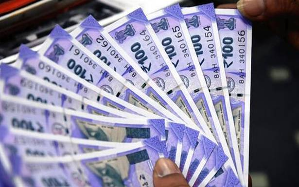 Rupee gains 5 paise to close at 74.54 against U.S. dollar